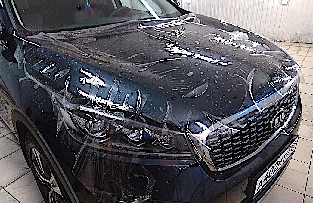 Бронирование антигравийной пленкой Hexis Bodyfence капота, фар автомобиля KIA Sorento Prime