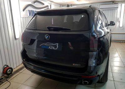 Тонирование фар темным винилом — BMW X5